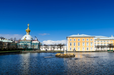PETERHOF, ST. PETERSBURG, RUSSIA - MAY 4, 2015: East Chapel flanking the central buildings of Grand Peterhof Palace with reflection