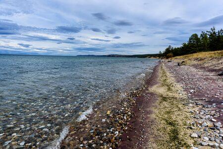 Lake Baikal and mountains of Siberia with beautiful sky and clouds, Russia Oklhon island