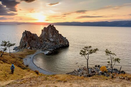 Shamanka Rock on Baikal lake near Khuzhir at Olkhon island in Siberia, Russia. Sunset in Lake Baikal