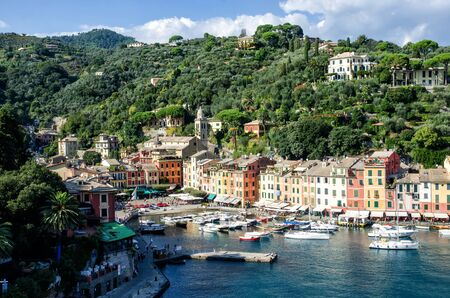 Sea bay with beautiful picturesque village called Portofino. Small marina port at the foot of mountain with a beautiful colourful houses village Stock Photo