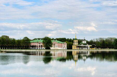 Moscow, RUSSIA-May 11, 2015: Kuskovo park, pond and Kuskovo palace. Kuskovo was the estate of the Sheremetev family.