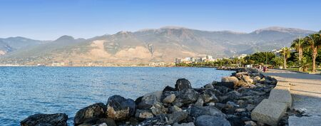 Embankment of Iskenderun city which is located on the eastern Mediterranean coast on the Gulf of Iskenderun in sunset. Iskenderun is one of the largest cities in Hatay Province.