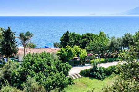 Panoramic view of beautiful blue sea and green trees Antalya, Turkey. Sunny summer day