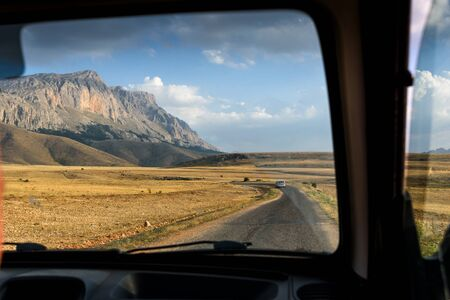 Journey through the centre of Turkey, look by the window of a car, Taurus mountains, Turkey