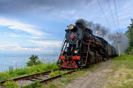 Old steam locomotive in the Circum-Baikal Railway in summer