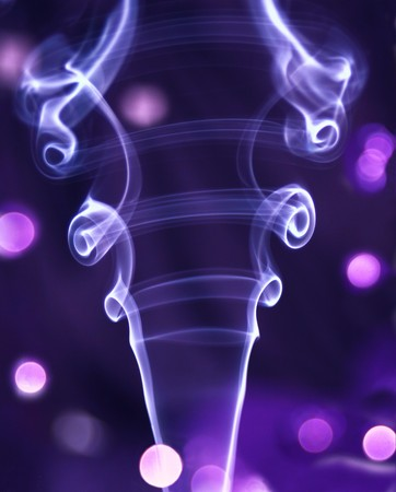 Smoke art, made with intense smoke, with shiny sequins for lights. Stock Photo