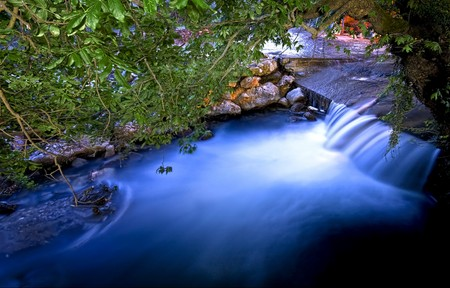 A peaceful flowing river under trees;  at Balikesir, Turkey. Ida Mountain.