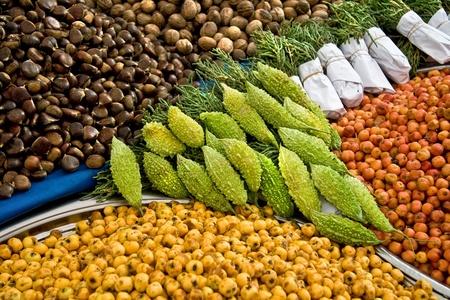 fatih: Fresh Organic Hawthorns and other goods At A Street Market In Istanbul, Turkey.  Carsamba Fatih Pazari (Bazaar)