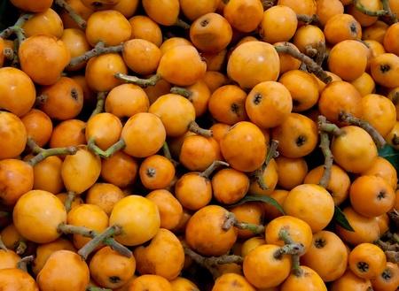 Heap Of Fresh Organic Loquats At A Street Market In Istanbul, Turkey.  Carsamba Fatih Pazari (Bazaar)