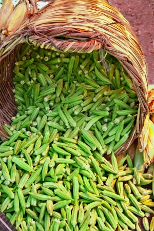 okra: Organic Okra Spilling From A Basket At A Street Market  Lady Fingers