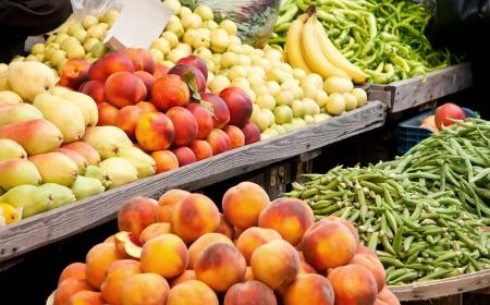 Fresh Organic Fruits and Vegetables At A Street MarketPeachs, Nectarine, Pears, Banana, Grean Pepper, Peas, and Green Beans