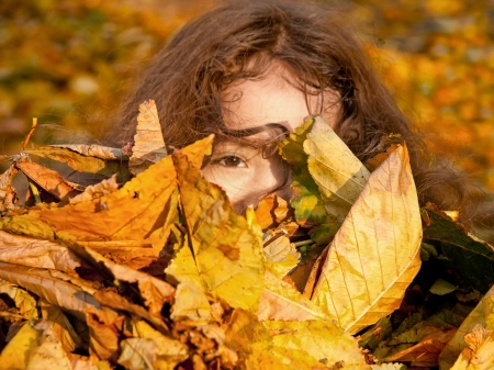 Holding A Bunch Of Yellow Leaves In Her Arms Stock Photo - 16631604