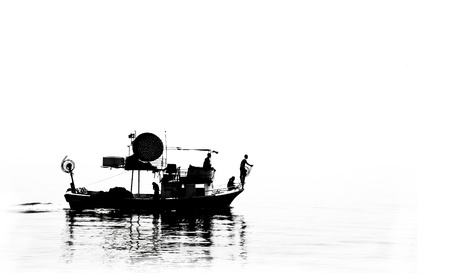 fishery: B&amp,W Silhouette of a fisher boat at open sea. Stock Photo