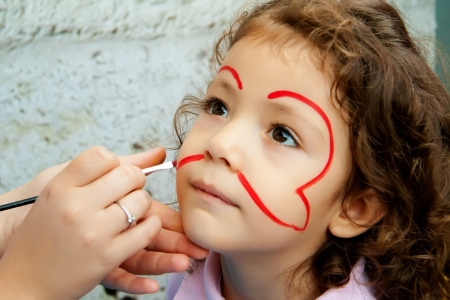 'face painting': By An Artist At A Festival          Stock Photo