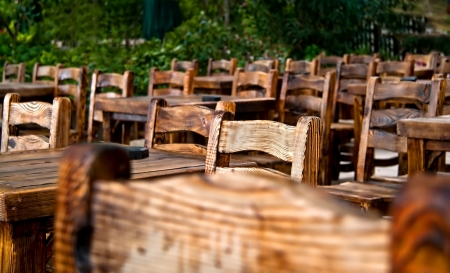 Empty Wooden Chairs and Tables At the cafe.