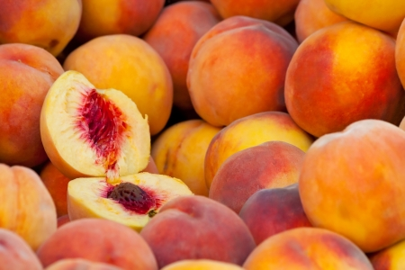 agriculture wallpaper: Heap Of Fresh Ripe Peaches At A Turkish Street Market.  Stock Photo