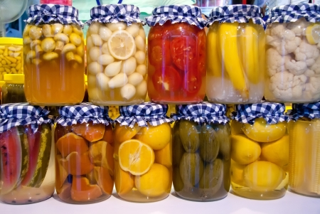 Pickled Banana, Watermelon, Lemon, Mushroom, Garlic, Tomato, Cauliflower, Pumpkin, Corn, Grapefruit, Gherkins, And Hot Pepper In Jars Stock Photo