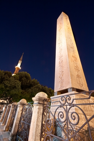 Obelisk and The Blue Mosque Minaret in the background at night  photo