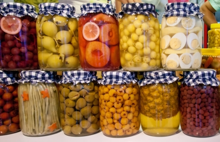 pickled: Pickled Pear, Grape, Peach, Cherry, String Bean, Almond, Hawthorn, Pineapple, Hot Pepper, Cranberry, And Eggs In Jars   Stock Photo