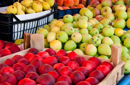 crate: Fresh Organic Fruits At A Street MarketNectarine, Peaches, Apple, And Pears Stock Photo