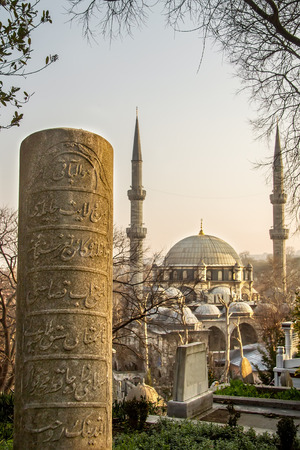 Historical Ottoman Headstone With Engravings And Eyup Sultan Mosque At Eyup, Istanbul photo
