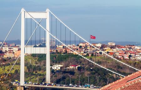 The second Bosphorus Bridge; The Fatih Sultan Mehmet in Istanbul, Turkey with Turkish flag Stock Photo