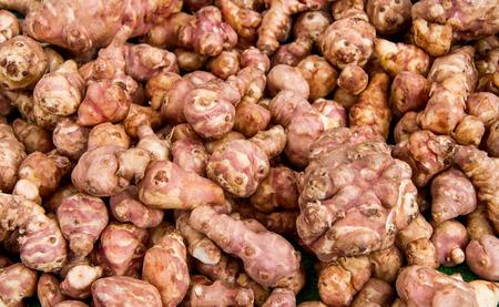 Organic Jerusalem Artichoke Root Heap At A Bazaar Stock Photo