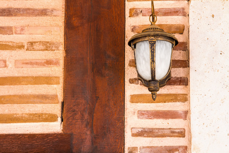 Lamp Hanging On A Newly Restorated Wooden And Brick Wall 版權商用圖片