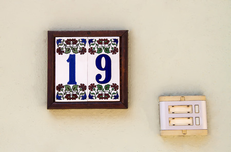 19  Numbered Tile As A Door Number With A Old Door Bell photo