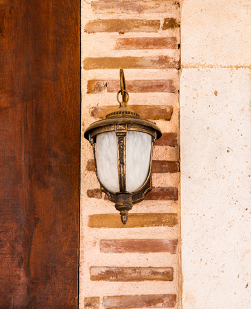 Lamp Hanging On A Newly Restorated Wooden And Brick Wall Stock Photo