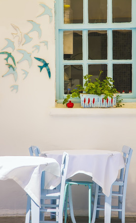 Blue Table With Chairs And A Blue Window At Bozcaada, Canakkale, Turkey Stock Photo