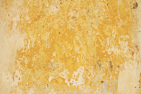 Old Wall With Weathered Yellow Paint Background Texture Stock Photo