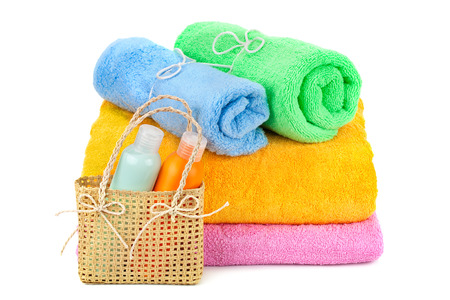 towels and shampoo isolated on white background photo