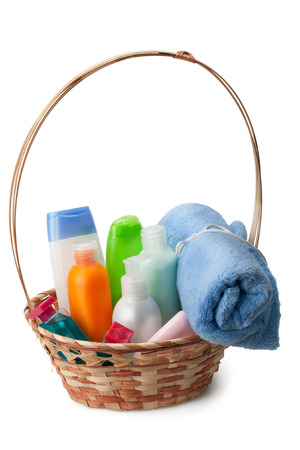 soft towel, soap, shampoo, cream, shower gel arranged in a basket photo