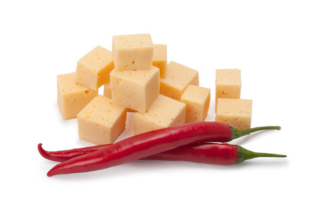 cubes of cheese and chili peppers isolated on white background photo
