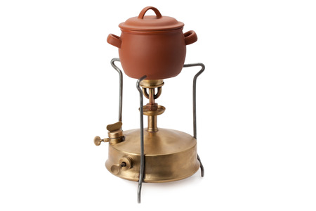 primus: kerosene burner and ceramic pot isolated on white background