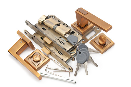 door handles, locks and keys isolated on white background photo