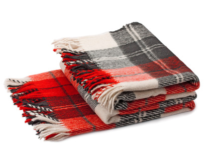 warm things: woolen plaid isolated on white background Stock Photo