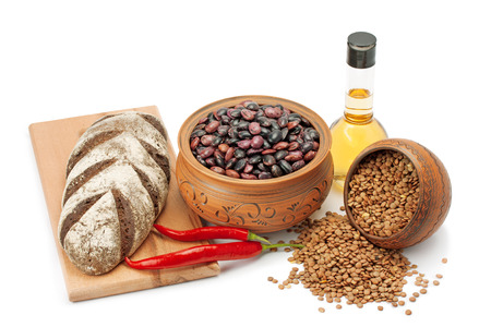 clay pots, legumes ,olive oil ,pepper and bread isolated on white background photo