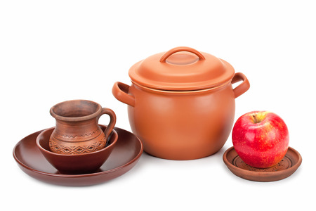 earthen pot: earthen pot, jug, plate and ripe apple isolated on white background Stock Photo