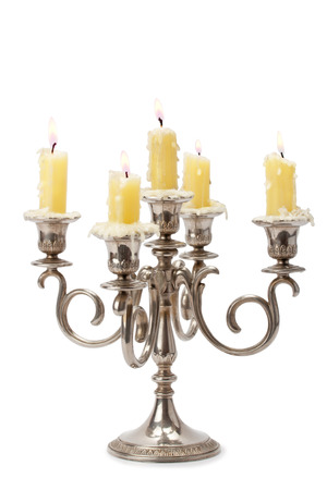 old candlestick with candles isolated on white background Archivio Fotografico