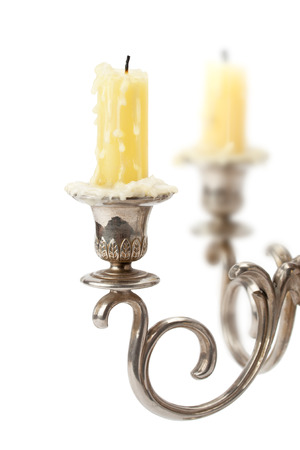 old candlestick with candles isolated on white background photo