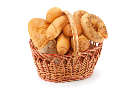 the basket: Composition with bread and rolls in wicker basket isolated on white Stock Photo