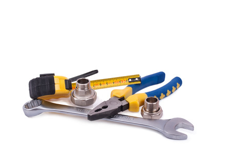 tire fitting: pliers spanner tape measure isolated on white background Stock Photo