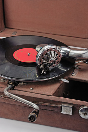 phonograph: old phonograph and vinyl record isolated on white background