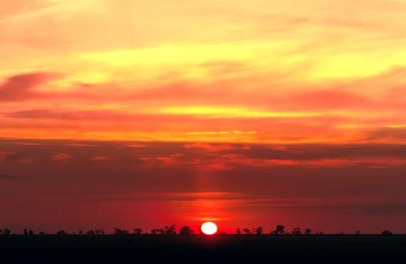 Fiery orange sunset sky. Beautiful evening sky.