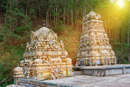 Beautiful statues in Tamil Hindu temple in the rays of rising sun,on the island of Sri Lanka.