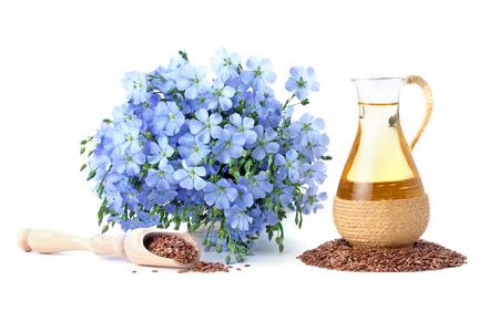 lijnzaadolie, lijnzaad en bloemen geïsoleerd op een witte achtergrond Stockfoto