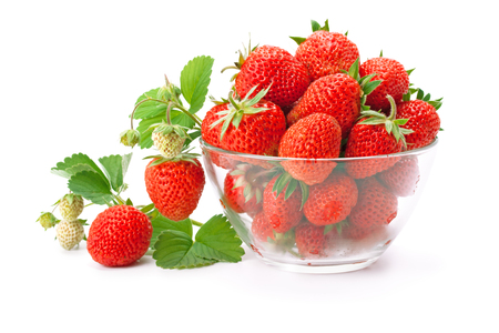 luscious: sweet fragrant strawberries in a glass vase isolated on white background