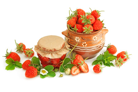 luscious: Strawberry jam and fresh berries isolated on white.